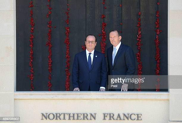 French President Francois Hollande and Prime Minister Tony Abbott walk along the Roll of Honour during a visit to the Australian War Memorial on...