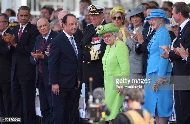 French President Francois Hollande and Queen Elizabeth II attend the International Ceremony at Sword Beach to commemorate the 70th anniversary of the...