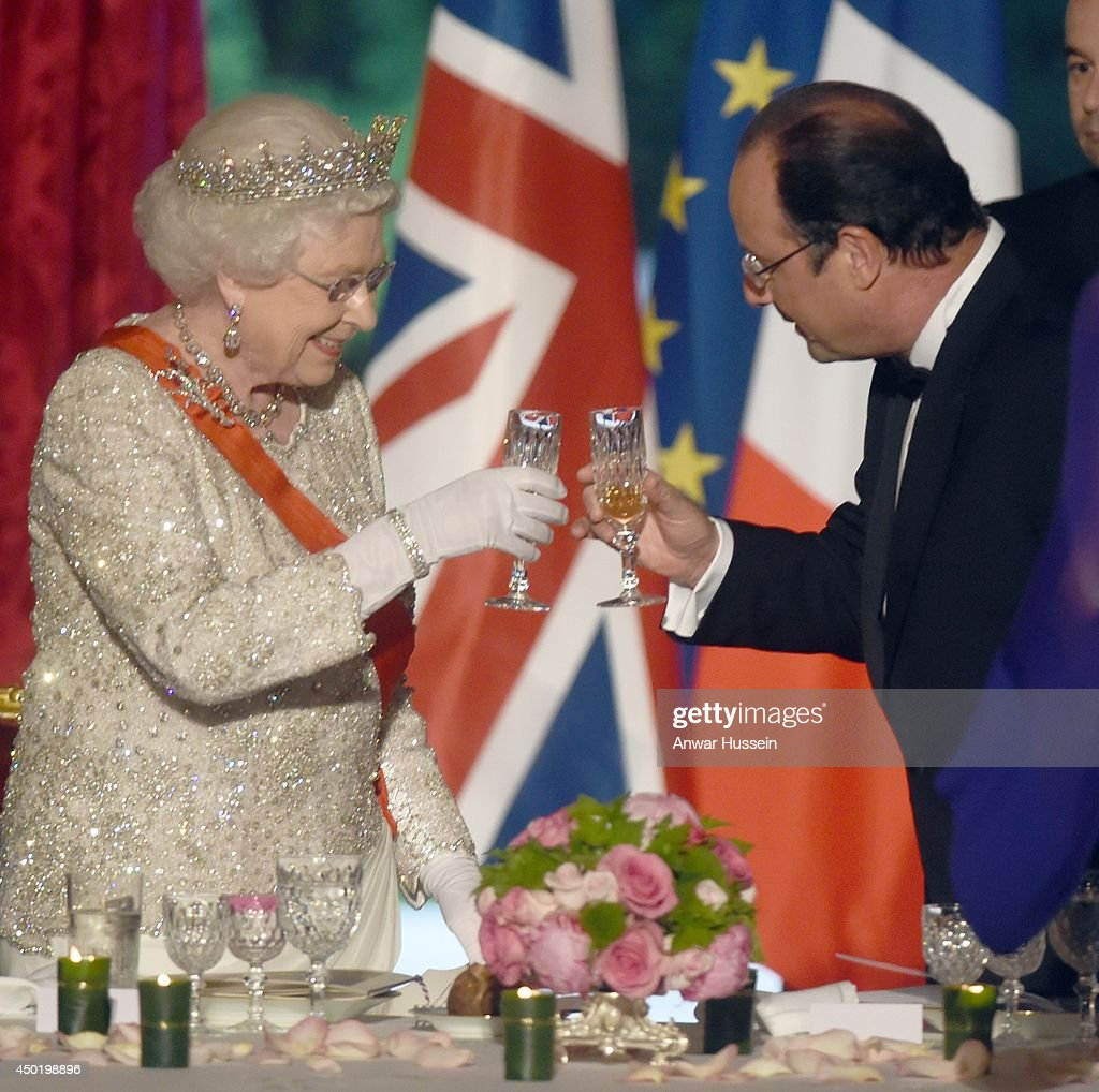 French President Francois Hollande and Queen Elizabeth ll toast each other during a State Banquet at the Elysee Palace on June 6, 2014 in Paris, France.