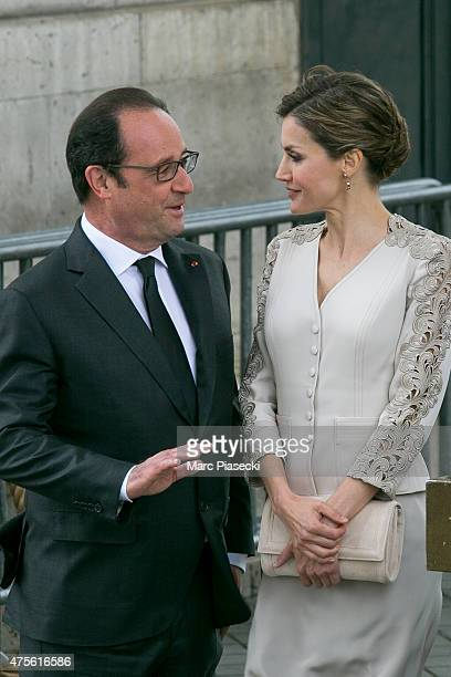 French President Francois Hollande and Queen Letizia of Spain are seen at Arc de Triomphe during the first day of a three-days official visit on June...