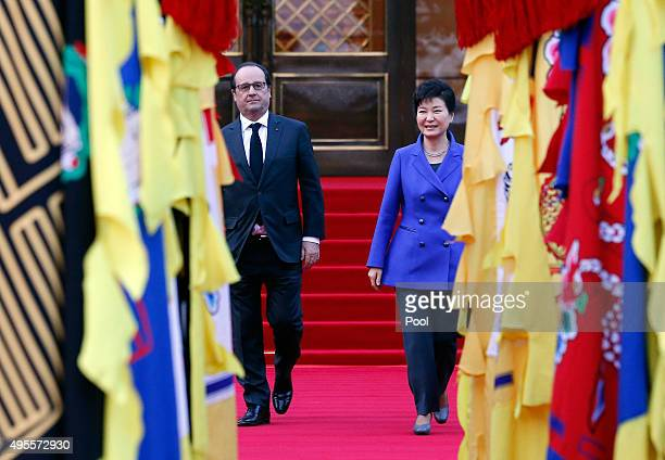 French President Francois Hollande and South Korean President Park Geun-Hye inspect a honor guard during a welcoming ceremony at the presidential...