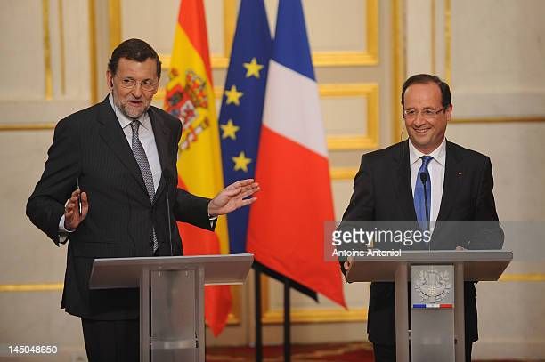 French President Francois Hollande and Spanish Prime Minister Mariano Rajoy speak during a press conference at Elysee Palace on May 23 2012 in Paris...