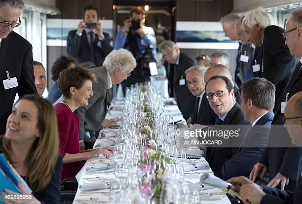 French President Francois Hollande and Swiss President Simonetta Sommaruga have lunch in the Swiss presidential train from Zurich to Lausanne, on...