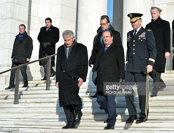 French President Francois Hollande and US Defense Secretary Chuck Hagel leave the Tomb of the Unknowns after laying a wreath at Arlington National...