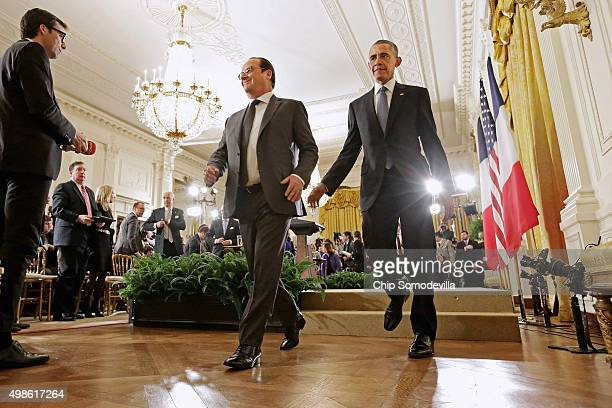 French President Francois Hollande and US President Barack Obama leave the East Room following a joint news conference at the White House November 24...