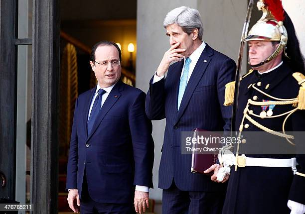 French President Francois Hollande and U.S. Secretary of State John Kerry leave Elysee Palace after a meeting on the Ukraine crisis on March 5, 2014...