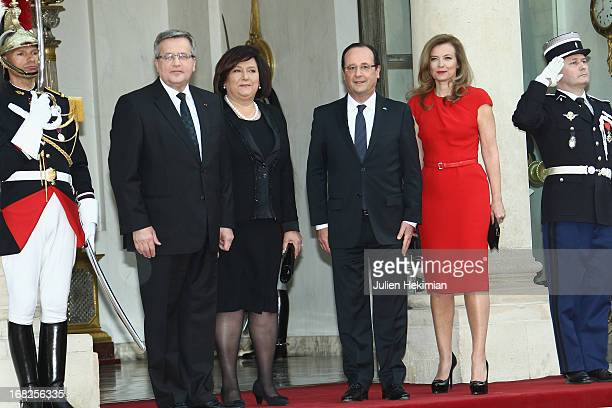 French President Francois Hollande and Valerie Trierweiler Poland President Bronislaw Komorowski and wife Anna Komorowska pose as they arrive to...