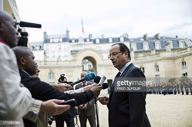 French president Francois Hollande answers reporters' questions after a meeting with the president of Comoros at the Elysee palace in Paris on June...