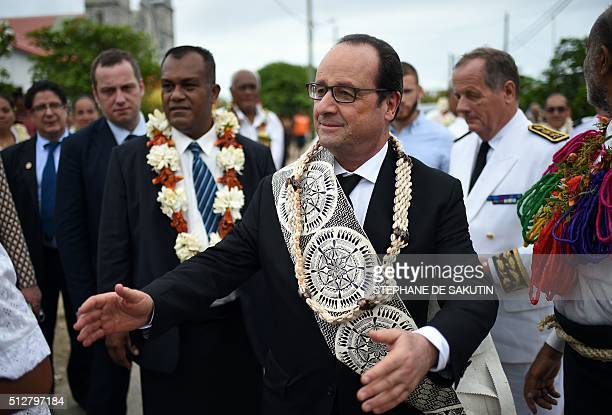 French President Francois Hollande arrives at a ceremony by 'la grande chefferie du royaume d'Alo' in Futuna island on February 22 in the French...