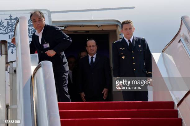 French President Francois Hollande arrives at the Capital Airport in Beijing on April 25 2013 Hollande accompanied by a highpowered business...