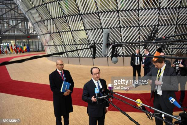 French President Francois Hollande arrives at the Council of the European Union on the first day of an EU summit on March 9 2017 in Brussels Belgium...