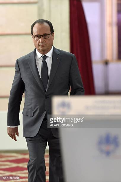 French president Francois Hollande arrives for his bi-annual press conference on September 7, 2015 at the Elysee presidential palace Paris. AFP PHOTO...