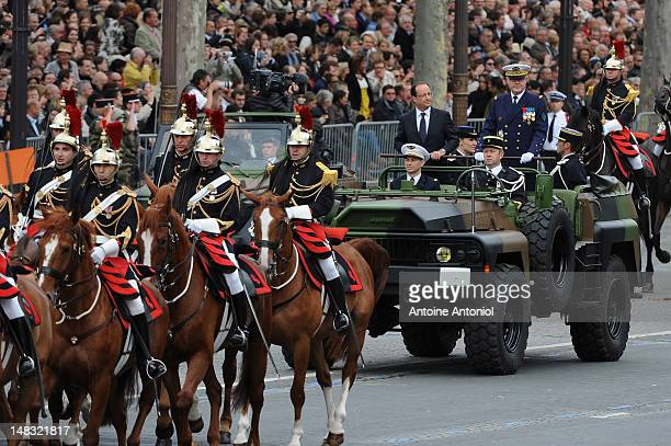 French President Francois Hollande arrives for the Bastille Day Military Ceremony on July 14 2012 in Paris France Francois Hollande saw in his first...