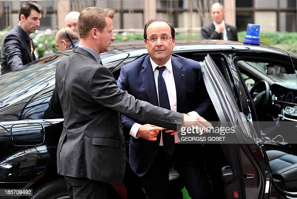 French President Francois Hollande arrives on October 24 2013 to attend a European Council meeting at the EU headquarters in Brussels European Union...