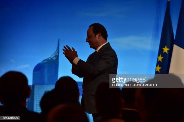 French President Francois Hollande arrives to address members of the French community in Jakarta on March 29 2017 Hollande is on the last day of his...
