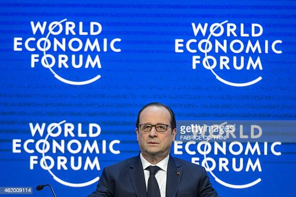 French President Francois Hollande arrives to deliver a speech at the World Economic Forum annual meeting on January 23 2015 in Davos French...