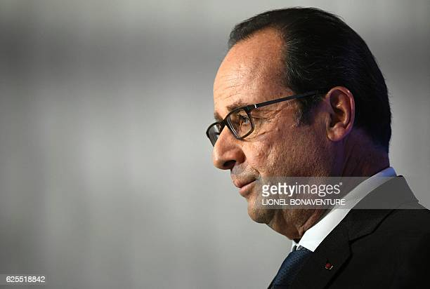 French president Francois Hollande arrives to deliver a speech on social contracts of employment at the end of the Conference on the social impact...
