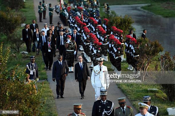 French President Francois Hollande arrives to pay a tribute at the FrenchMadagascan memorial on the sidelines of the 16th 'Sommet de la Francophonie'...