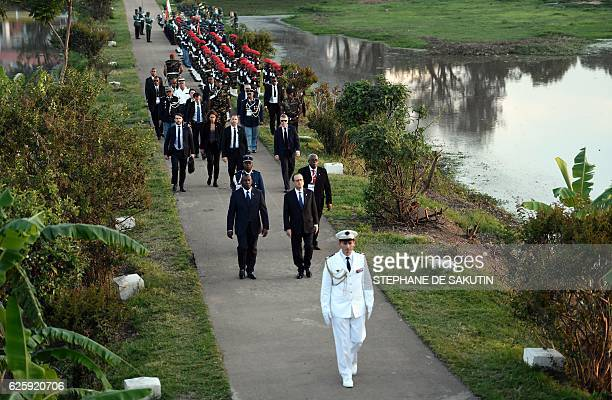 "French President Francois Hollande arrives to pay a tribute at the French-Madagascan memorial on the sidelines of the 16th ""Sommet de la..."