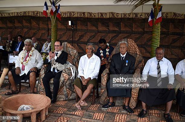 French President Francois Hollande attends a ceremony by 'la grande chefferie du royaume d'Alo' in Futuna island on February 22 in the French...