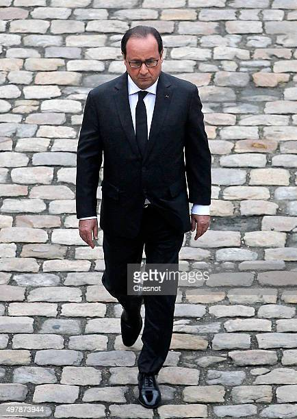 French President Francois Hollande attends a military ceremony in the courtyard of the Hotel des Invalides on November 19 2015 in Paris France The...