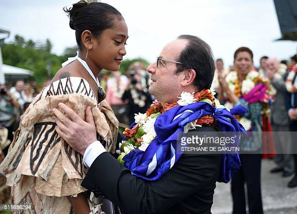 French President Francois Hollande attends a welcoming ceremony upon his arrival in Futuna island on February 22 in the French overseas territory of...