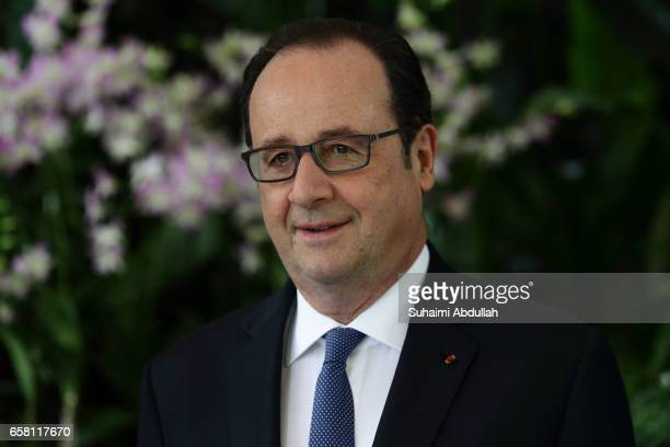 French President Francois Hollande attends the orchid naming ceremony at the National Orchid Gardens on 27 March 2017 in Singapore Francois Hollande...