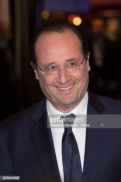 French President Francois Hollande attends the premiere of 'Aimer Boire et Chanter' in Paris