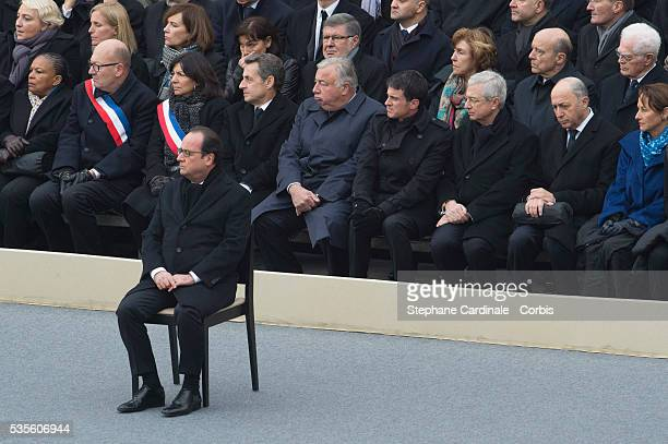 French President Francois Hollande attends with French Justice minister Christiane Taubira Saint Denis' mayor Didier Paillard Paris' mayor Anne...