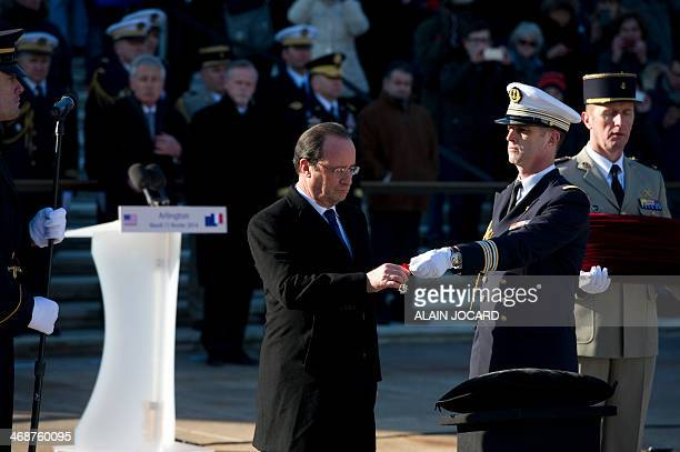French President Francois Hollande awards the Legion of Honor to the WWII Unknown Soldier at Arlington National Cemetery on February 11 2014 in...