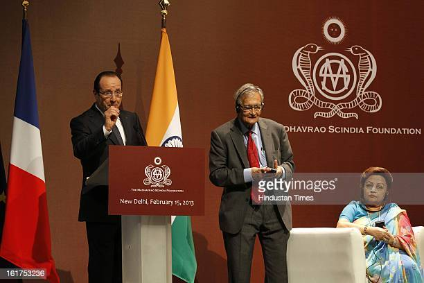 French President Francois Hollande before honoring Amartya Sen with Commandeur de la Legion d' Honneur as wife of late Madhavrao Scindia Madhavi raje...
