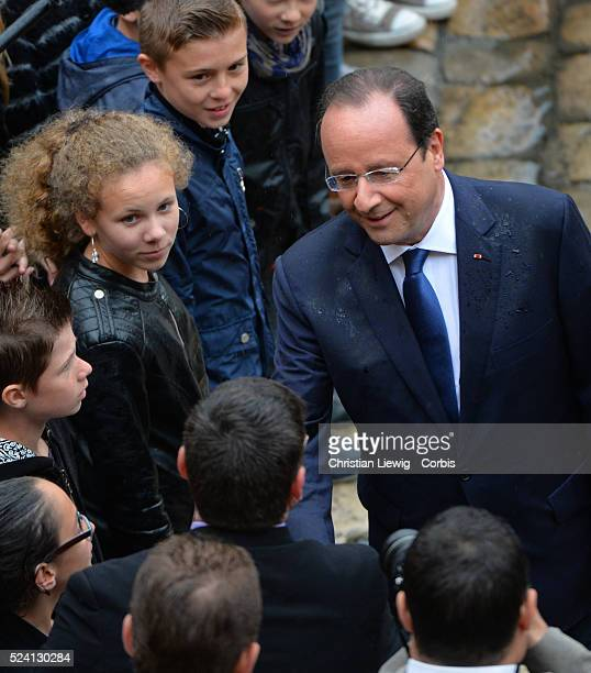 French President Francois Hollande, center, reviews the troops during a bi-annual military ceremony at Les Invalides in Paris, Thursday, May 22,...