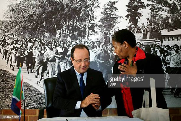 French President Francois Hollande chats with Antoinette Sithole sister of the first victim of the June 16 Soweto uprising Hector Pietersen during a...