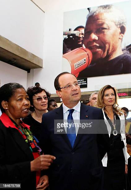 French President Francois Hollande chats with Antoinette Sithole sister of the first victim of the June 16 Soweto uprising Hector Pietersen as his...