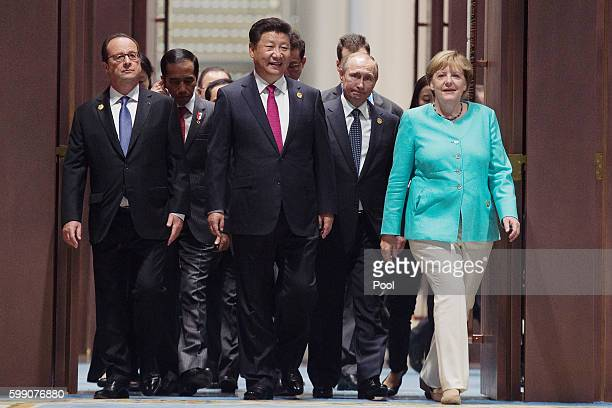 French President Francois Hollande Chinese President Xi Jinping Russia's President Vladimir Putin and German Chancellor Angela Merkel arrive for the...