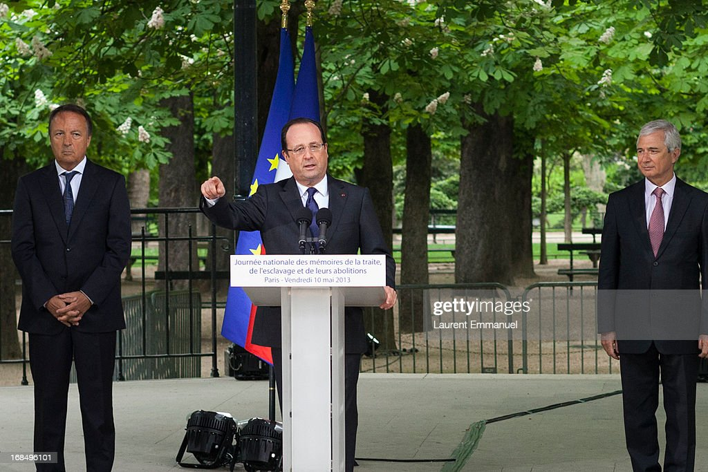 French President Francois Hollande (C) delivers a speech as President of the French Senate Jean-Pierre Bel (L) and President of the French National Assembly Claude Bartolone look on during a ceremony marking the abolition of slavery in the Jardins du Luxembourg on May 10, 2013 in Paris, France. Taubira Law was passed in May 2001 acknowledging slavery and the Atlantic slave trade as crimes against humanity.