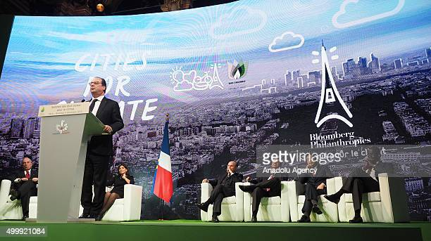 French President Francois Hollande delivers a speech during the Climate Summit for Local Leaders at the Paris Townhall in Paris France on December 4...