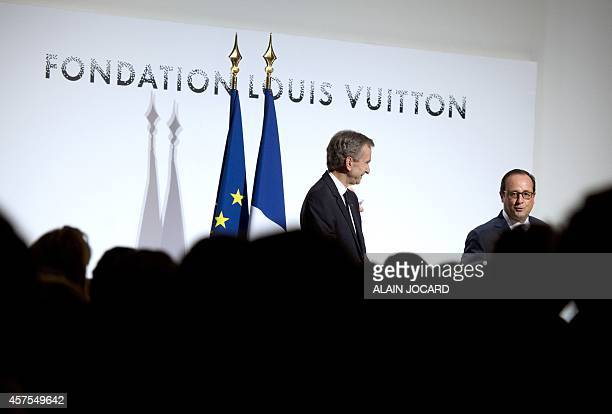 French President Francois Hollande delivers a speech next to Bernard Arnault who heads up the LVMH luxury goods empire at the Louis Vuitton art...