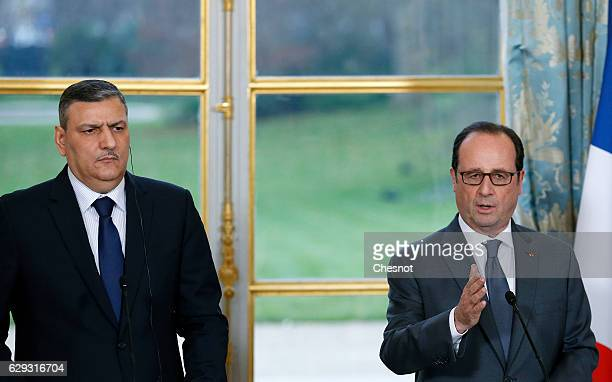 French President Francois Hollande delivers a speech next to Riad Hijab chief coordinator of the Syrian opposition's High Negotiations Committee...