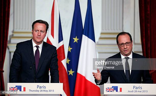 French President Francois Hollande delivers a speech with British Prime Minister David Cameron during a press conference after their meeting at the...