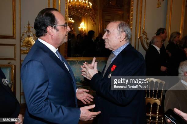 French President Francois Hollande elevates Claude Brasseur to the rank of Officier de la Legion d'Honneur at Elysee Palace on March 13 2017 in Paris...