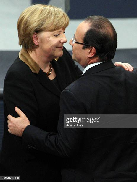 French President Francois Hollande embraces German Chancellor Angela Merkel during a joint session of the German Bundestag and French Assemblee...