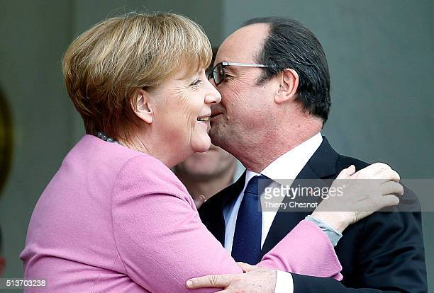French President Francois Hollande embraces German Chancellor Angela Merkel after their meeting at the Elysee palace on March 04 2016 in Paris Angela...
