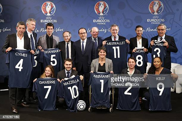 French President Francois Hollande flanked by French Football Federation president Noel Le Graet and Euro 2016 President Jacques Lambert poses with...