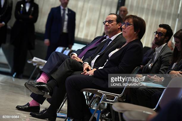 French president Francois Hollande flanked by French junior minister for Trade Handicraft and Social and Solidarity Economy Martine Pinville and...