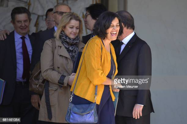 French President Francois Hollande formally says goodbye to French Minister of Labor Employment and Social dialogue Myriam El Khomri as she leaves...