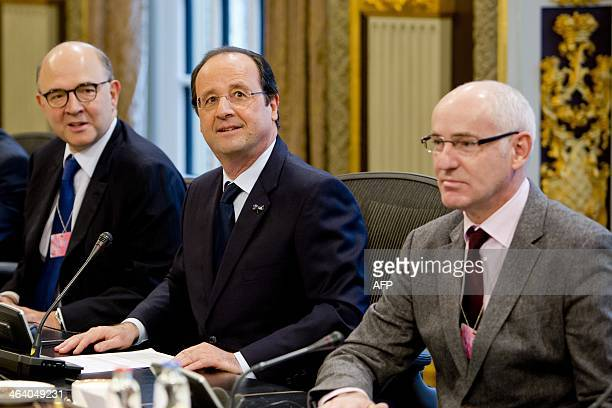 French President Francois Hollande French Economy Finance and Foreign Trade Minister Pierre Moscovici and French Junior Minister for European Affairs...
