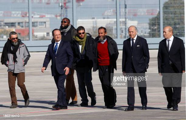 French president Francois Hollande French Foreign Affairs Minister Laurent Fabius and Defence Minister JeanYves Le Drian welcome former French...