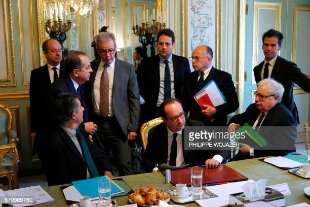 TOPSHOT French President Francois Hollande French President's Chief of Staff JeanPierre Jouyet French Interior Minister Matthias Fekl French Prime...