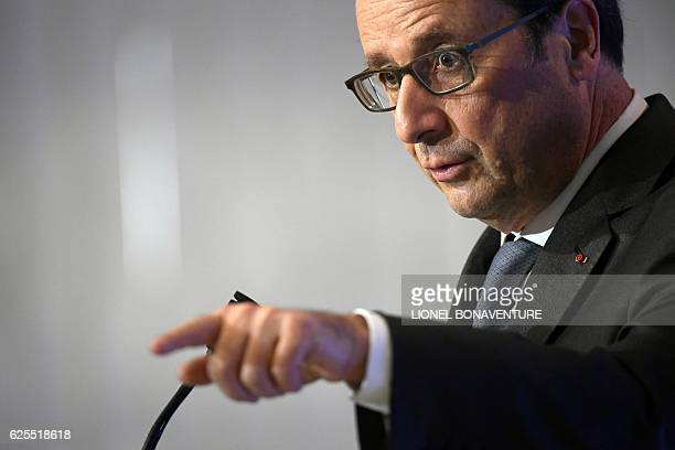 French president Francois Hollande gestures as he delivers a speech on social contracts of employment at the end of the Conference on the social...